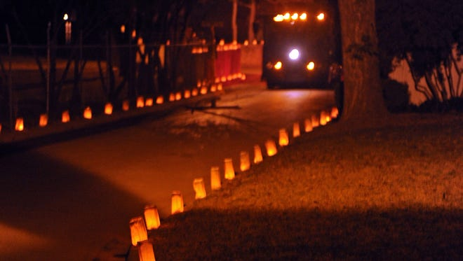 A Wichita Falls trolley travels down Grant Street toward Crestway Street as luminarias line the roadway in the Morningside Addition in this file photograph.