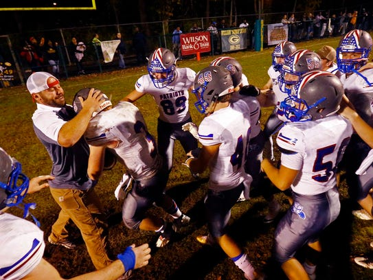 Page players celebrate their win over Gallatin in overtime,