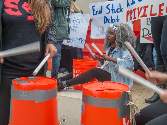 Shiba Bandeeba, of San Fransico State, plays the bucket at a protest with other students and supporters outside of the California State University Office of the Chancellor as trustees vote on a tuition increase in Long Beach on Wednesday.