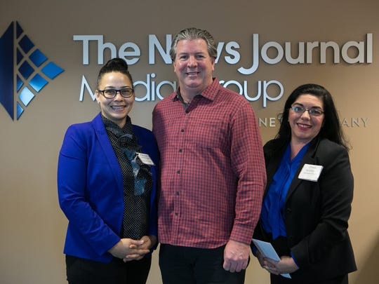 Natalie Armor-Payne (left) and Dina Melchiorre (right) with Delaware Futures receive a Gannett Foundation Grant from Thomas Donovan, President/Publisher and Northeast Regional President of Gannett East Group.