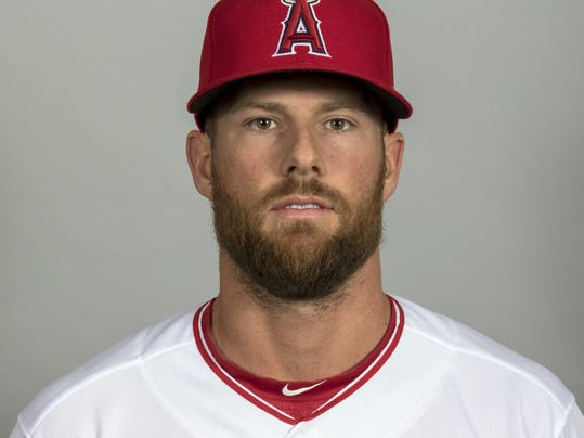 FILE - This 2018, file photo, shows Zack Cozart of the Los Angeles Angels baseball team. Cozart was all set to move from shortstop to second base after leaving Cincinnati for a $38 million, three-year contract with the Angels. Then general manager Billy Eppler asked whether he would be willing to shift to third, which would allow Los Angeles to acquire Ian Kinsler from Detroit. Cozart admitted being a little shocked but agreed. (AP Photo/Darryl Webb, File)