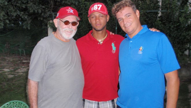 In this 2013 photo, Lafayette author Peter Bjarkman, left, poses with Cuban national team star and recent defector Yulieski Gourriel and sports ministry vice president Anthony Castro.