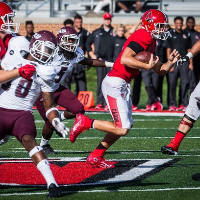 Ball State's Riley Neal runs the ball against Eastern