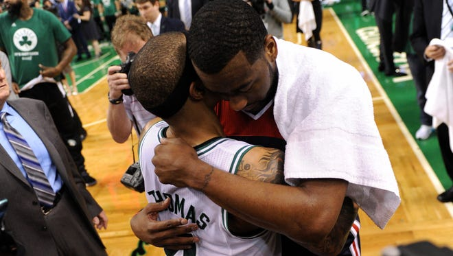 Boston Celtics guard Isaiah Thomas (4) hugs Washington Wizards guard John Wall (2) after defeating the Wizards in game seven of the second round of the 2017 NBA Playoffs at TD Garden on May 15.