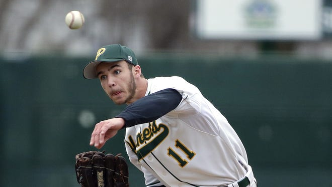 Green Bay Preble senior Caleb Schoenholz releases a pitch against Pulaski at Joannes Stadium on April 19. Schoenholz threw a no-hitter on Tuesday to propel the Hornets to state for the first time since 2002.