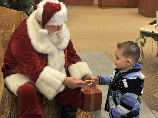 Two-year-old Elijah Baier received a small gift from Santa Claus in the Lobby of the First Nation Bank located at Kell Freeway at Fairway Blvd. Parents were encouraged to bring their kids out to see Santa Claus and to take pictures of the memorable moment.