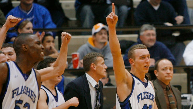 John Ashworth (right) leads the Franklin Central celebration in the championship game of the 2007 Marion County tournament. JaJuan Johnson is to the left.
