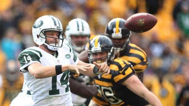 Jets quarterback Ryan Fitzpatrick  passes the ball against the Pittsburgh Steelers during the fourth quarter of Sunday's at Heinz Field in Pittsburgh. The Steelers won 31-13.