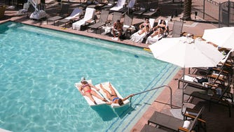 Guests enjoy the main pool at the Fairmont Scottsdale Princess.