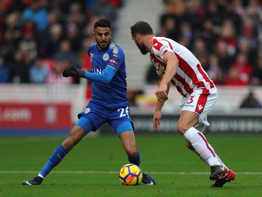 Leicester City's Riyad Mahrez, left, and Stoke City's Erik Pieters battle for the ball during their English Premier League soccer match at the bet365 Stadium, Stoke-on-Trent, England, Saturday, Nov. 4, 2017. (Aaron Chown/PA via AP)