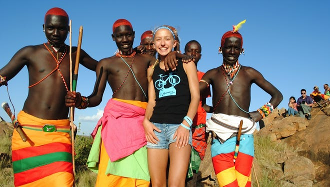 Winter Vinecki with some of the native residents of Kenya where she ran the second of two continental marathons in September 2012. Her first was in Eugene, also in 2012. She has also run the 26.2 mile race in Antarctica, and hopes to complete one more on every continent by December 2013 -- before she turns 15.