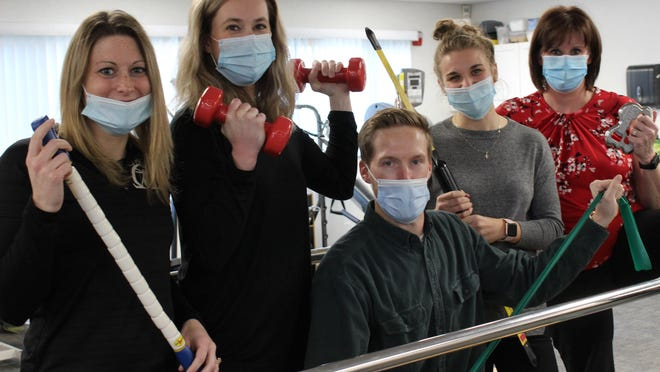 From left, Kayla Blaker, Ashley Clemons, Max Patterson, Emily Calvert, and Tonya Booher of Omega Physical Therapy.