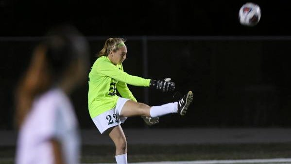 Melbourne goalkeeper Jessica Newton sends the ball downfield during Wednesday's District 6-4A semifinal game in Melbourne