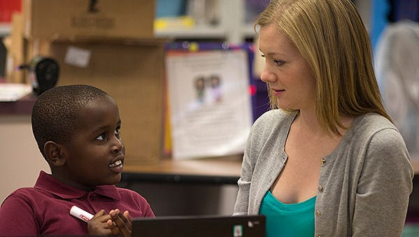 Second-grader Mohamed Sugow gets one-on-one attention from student teacher Victoria Garrison during class at David Crockett School. The school is in the Balsz School District, which is seeking a $1.4 million override.