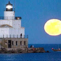 A full moon rises over Lake Michigan.