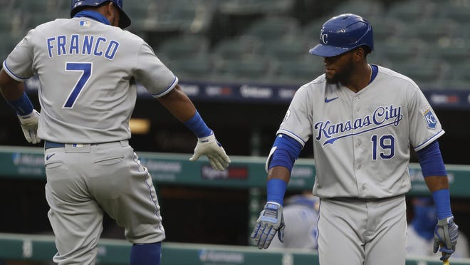 Kansas City Royals third baseman Maikel Franco (7) celebrates with teammate Franchy Cordero (19) after hitting a solo home run during the second inning against the Detroit Tigers Monday at Comerica Park. Franco hit two of the Royals' six home runs in a 14-6 victory.