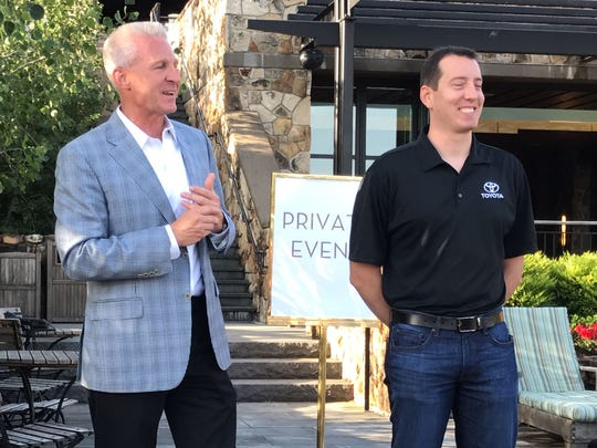 Toyota Division general manager Jack Hollis and NASCAR driver Kyle Busch at the introduction of the 2018 Camry in Portland, Oregon in June 2017.