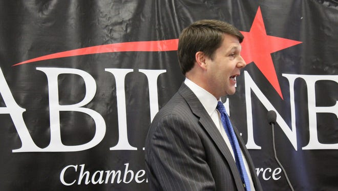 Congressman-elect Jodey Arrington jokes with Abilene Mayor Norm Archibald during his brief address at Tuesday's Abilene Legislative Collective breakfast at the Abilene Convention Center.