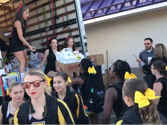 South Brunswick cheerleaders drop off donated toys