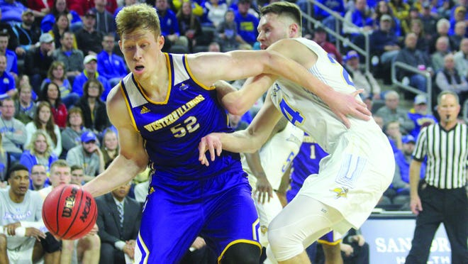 Western Illinois' graduate Brandon Gilbeck goes to the basket during a Summit League Tournament game during his season year.
