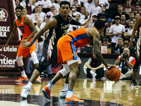 Xavier Rathan-Mayes (22) guards a Florida player during