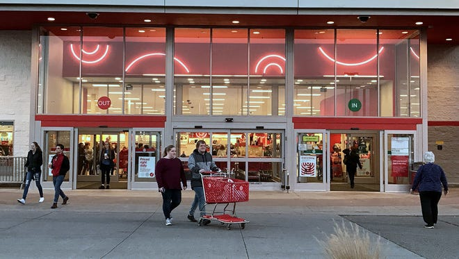 Shoppers enter and leave the Target department store in Big Flats on Friday morning.