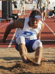 Oak Creek's James Carter lands a long jump en route