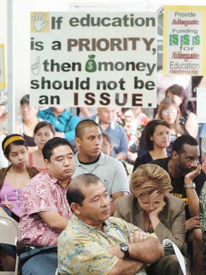 "In this 2006 file photo, members of the public attend a meeting about the Guam Public School System's financial crisis at the Legislature. Nine years on, the the Guam Department of Education still struggles to keep facilities maintained and the island's budget talks are riddled with shortfalls and a $65 million ""paper deficit."""