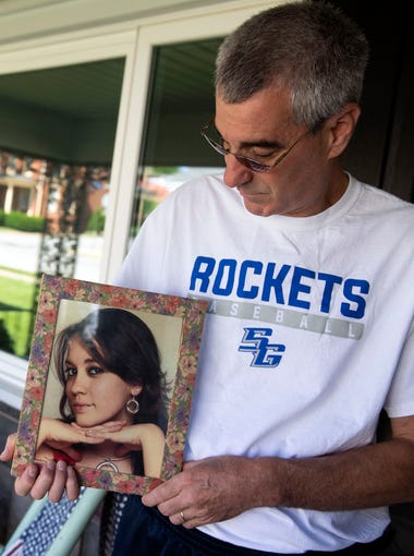 Bob Sterner poses for a portrait while holding a photo of his younger sister, Danielle Taylor, Thursday, June 14, 2018. Taylor was killed in September 2016.