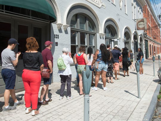 A line down the street forms as Anthony Ray Hinton,