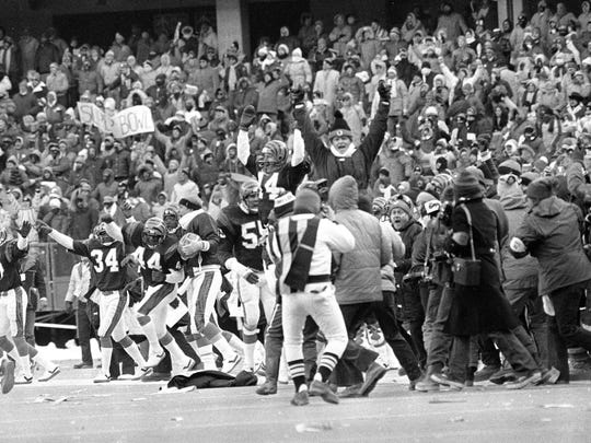 The Cincinnati Bengals break out in celebration after defeating the San Diego Chargers 27-7 in the AFC championship game in Cincinnati, Jan. 10, 1982.