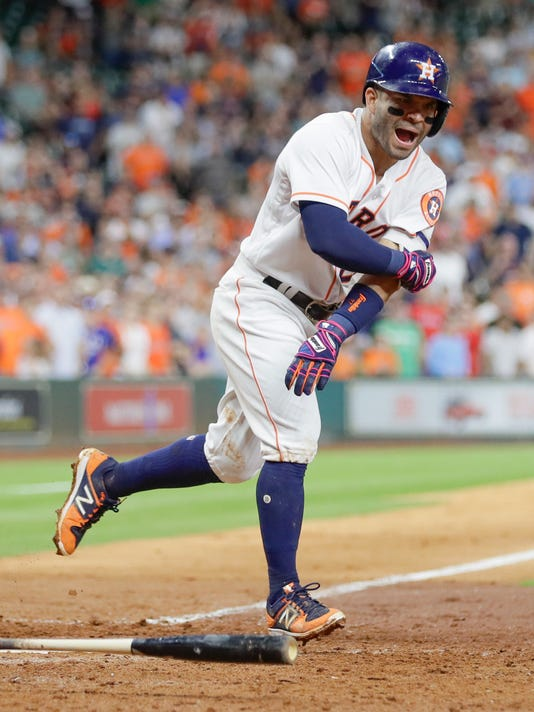 Houston Astros' Jose Altuve reacts after a ball four call against the Texas Rangers during the eighth inning of a baseball game, Tuesday, May 2, 2017, in Houston. (AP Photo/David J. Phillip)