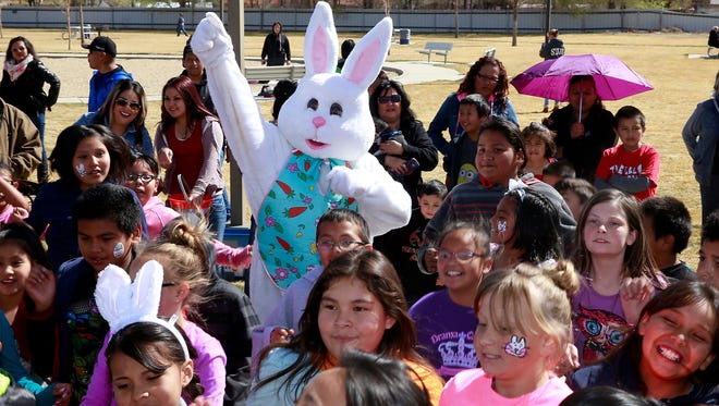 The Easter Bunny dances with kids during the Easter EGGstravaganza on March 25, 2016, at the Sycamore Park Community Center.