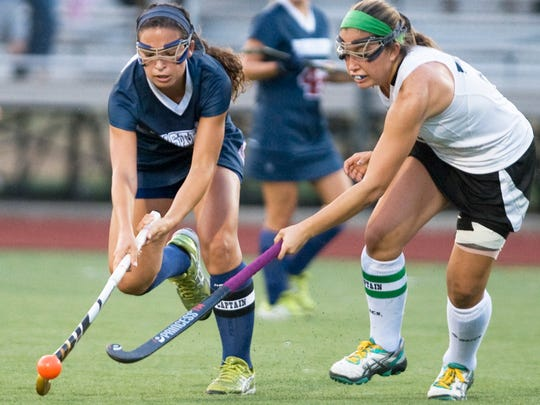 Eastern's Kasey Morano (left) controls the ball next to Bishop Eustace's Sarah Furey during a  field hockey game last fall.