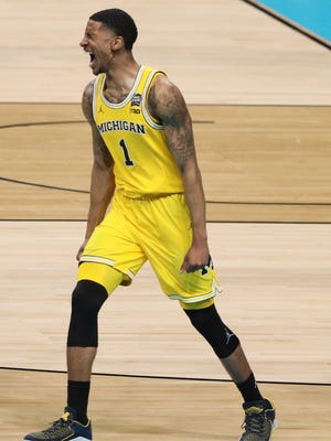 Michigan Wolverines guard Charles Matthews (1) celebrates in the second half against the Loyola Ramblers in the semifinals of the 2018 men's Final Four at Alamodome.