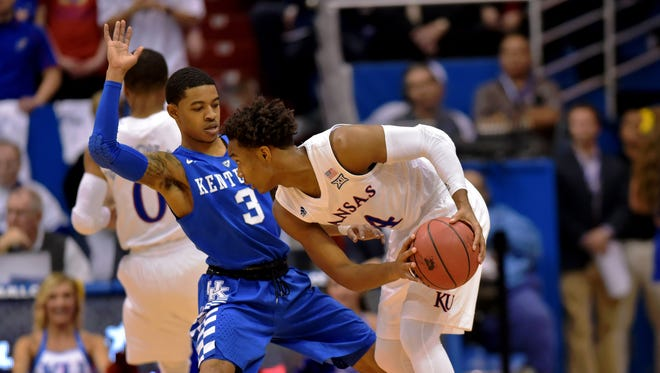 Jan 30, 2016; Lawrence, KS, USA; Kansas Jayhawks guard Devonte' Graham (4) looks to pass as Kentucky Wildcats guard Tyler Ulis (3) defends during the first half at Allen Fieldhouse. Kansas won the game 90-84 in overtime.