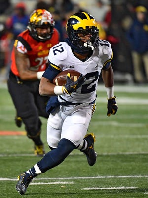 Michigan running back Chris Evans (12) rushes the ball during the second half of U-M's 35-10 win on Saturday against Maryland.