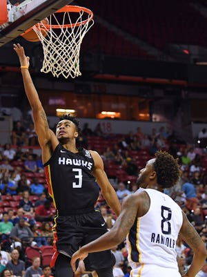 Jaylen Morris (left), who played with the Atlanta Hawks in summer league, signed a two-way deal with the Bucks.