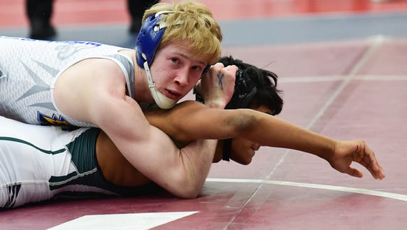 Eastside's Jordie White beat Beaufort's Luis Pantoja to win the Class AAAA 120-pound state championship Saturday at the Civic Center of Anderson. KEN RUINARD/STAFF