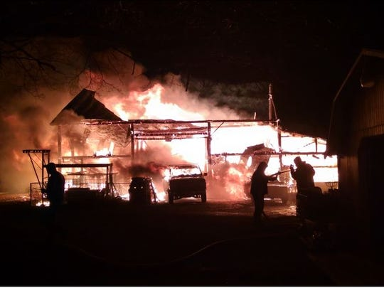 Journalist Randa Wagner took this photo of her burning barn early Thursday morning on Crestline  Road. Cause of the fire remains under investigation.