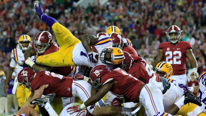 LSU running back Leonard Fournette is tackled by the Alabama defense in 2015.