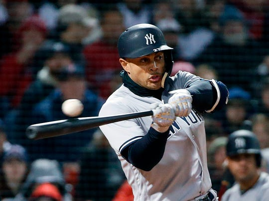 New York Yankees' Giancarlo Stanton strikes out during
