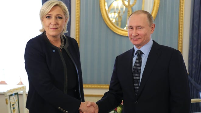 Russian President Vladimir Putin meets with French presidential election candidate for the far-right Front National party Marine Le Pen at the Kremlin in Moscow on March 24, 2017.