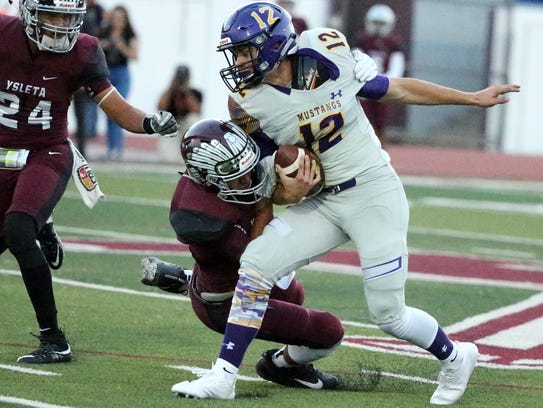 Burges wide receiver Christian Yeager, 12, is brought