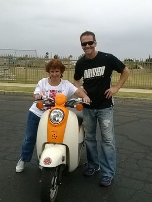 Deer Valley boys basketball  coach Jed Dunn,  with help from his former player, Roy Hall, who runs Driven Foundation to help those  in  need, brought  a new scooter to Tammy Hastings.