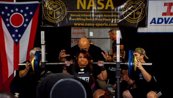 Destiny-Hope Siguenza competes at the Natural Athlete Strength Association in Springfield, Ohio. Siguenza broke seven national records at the event.