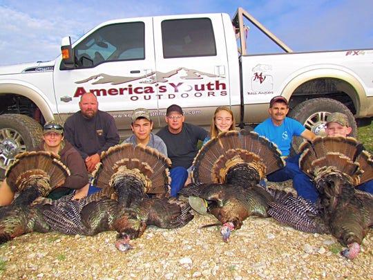 Donald R. Kemp Youth Hunting Club members hunt turkeys in Texas.
