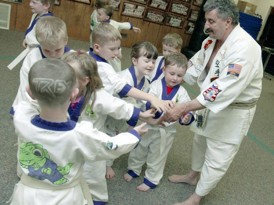 George Annarino shook hands with his Little Dragons students at his Newark martial arts school, after a training session in 2006.