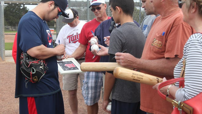 Byung-ho Park, a new addition to the Minnesota Twins, signs autographs during practice at the CenturyLink Sports Complex on Monday.