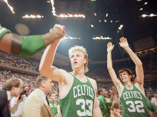 Boston Celtics Larry Bird (33) gets a congratulation as teammate Kevin McHale (32) goes up with his arms in victory over the Houston Rockets in game four by score of 106-103, Tuesday, June 4, 1986, Houston, Tex. (AP Photo/F. Carter Smith)
